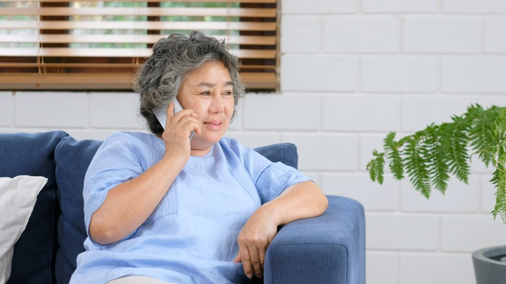 Woman talking on phone Family1st